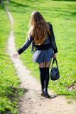 Woman walking on a footpath in the park Royalty Free Stock Photos