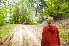 Woman walking in forest Royalty Free Stock Image