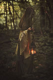 Woman walking in a forest with lantern Royalty Free Stock Images
