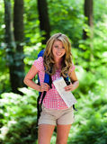 Woman Walking in the forest recreation. Young Woman Hiking in the recreation in the forest Stock Photo
