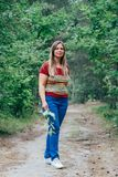 Woman walking at the forest. Relaxed middle aged woman walking at the forest Royalty Free Stock Photography