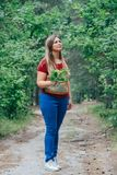 Woman walking at the forest. Relaxed middle aged woman walking at the forest Stock Photo