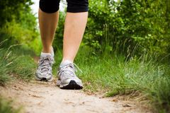 Woman walking in forest, sport shoes Royalty Free Stock Photography