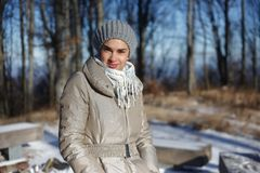 Woman walking in forest in winter Royalty Free Stock Image