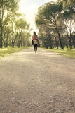Woman walking in the forest Stock Photography