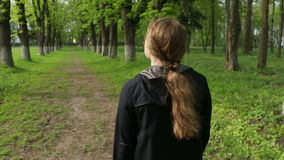 Woman walking forest. Young female walking among trees in forest stock video