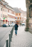 Woman walking in French village Alsace, Thann Royalty Free Stock Images