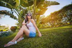 Woman is walking in the garden with palm trees Royalty Free Stock Photo