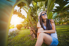 Woman is walking in the garden with palm trees Royalty Free Stock Photography