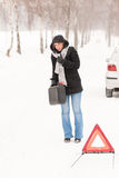 Woman walking with gas can car snow Royalty Free Stock Image