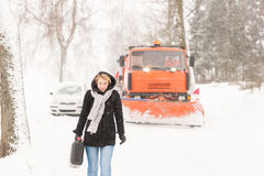 Woman walking with gas can winter car. Woman walking with gas can snow car road winter trouble royalty free stock photos