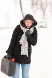 Woman walking with gas can winter car. Woman walking with gas can snow car road winter trouble royalty free stock images