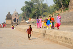 Woman walking on the ghat of Maheshwar on India Royalty Free Stock Images