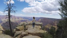 Woman walking in Grand Canyon. Near cliff stock footage