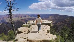 Woman walking in Grand Canyon. Near cliff stock video footage