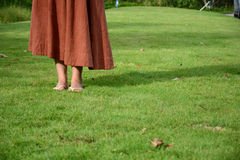 Woman walking on the grass Stock Image