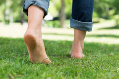 Woman walking on grass Stock Photography