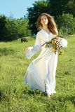 Woman walking on the grass outdoors royalty free stock photos