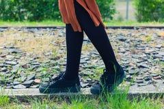 Woman walking on gravel Royalty Free Stock Image