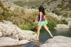 Woman walking on a Gredos river Royalty Free Stock Photography