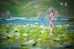 Woman Walking on the Green Reef Stock Image