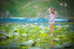 Woman Walking on the Green Reef Royalty Free Stock Image