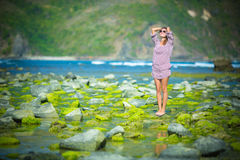 Woman Walking on the Green Reef Stock Photos