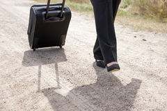 Woman walking with hand luggage suitcase Royalty Free Stock Photos