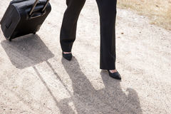Woman walking with hand luggage suitcase Stock Photos