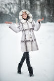 Woman walking and having fun on the snow in winter forest Royalty Free Stock Photography
