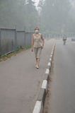 Woman walking in Heavy Smog Royalty Free Stock Image