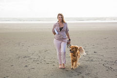 Woman walking her dog Stock Photos