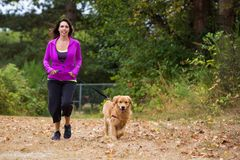 Woman walking her dog Royalty Free Stock Photo
