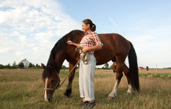 Woman walking with her horse Royalty Free Stock Photos