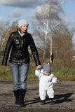 Woman is walking with her son Stock Images