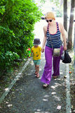 Woman walking with her son Royalty Free Stock Images