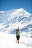 Woman walking and hiking in mountains Stock Photos