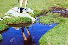 Woman walking with hiking sticks Stock Image