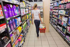 Woman walking with his trolley on aisle Royalty Free Stock Image