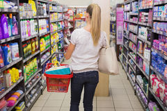 Woman walking with his trolley on aisle Royalty Free Stock Photo
