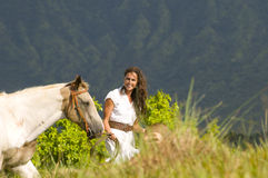 Woman walking with a horse Stock Photo