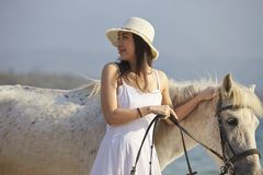 A woman walking horse on beach Royalty Free Stock Images