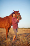 Woman walking with horse Stock Photography