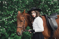 Woman walking with horse Royalty Free Stock Photos