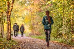 Free Woman Walking In Autumn Forest Nature Path Walk On Trail Woods Background. Happy Girl Relaxing On Active Outdoor Stock Image - 193897301