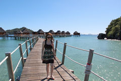 Woman walking at island resort in Fiji Royalty Free Stock Photo