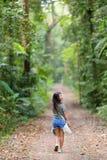 Woman walking in jungle Stock Photo