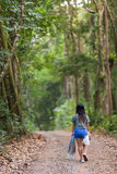 Woman walking in jungle Royalty Free Stock Photos