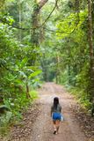 Woman walking in jungle Royalty Free Stock Images