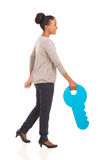 Woman walking key Stock Photography